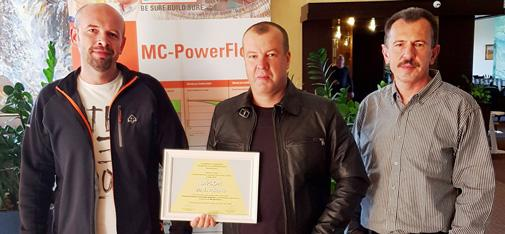 The MC team of Martin Struk, Michal Lehký and Milan Řičica (from left to right) proudly show off the certificate for first place in the SAVT competition for the strongest UHPC concrete.
